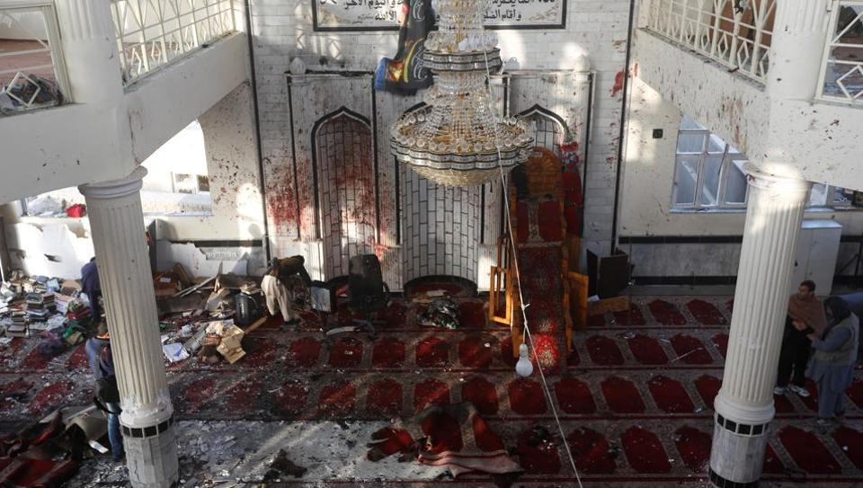 Afghan men inspect inside a Shi'ite Muslim mosque after last night attack in Kabul, Afghanistan October 21, 2017.