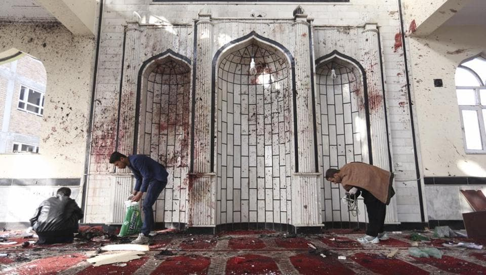 Afghans inspect inside a damaged mosque in Kabul, Afghanistan, Saturday, Oct. 21, 2017, a day after a suicide attack. Suicide bombers struck two mosques in Afghanistan during Friday prayers.