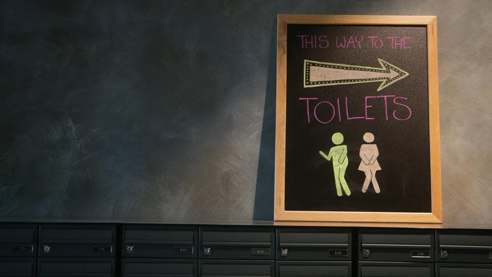 A toilet sign is seen on top of the post boxes at the co-living building. Some rooms in the building have a tiny ensuite bathroom with a small wash basin placed almost over the toilet. In others, the washroom areas are shared.  (Daniel Leal-Olivas / AFP)