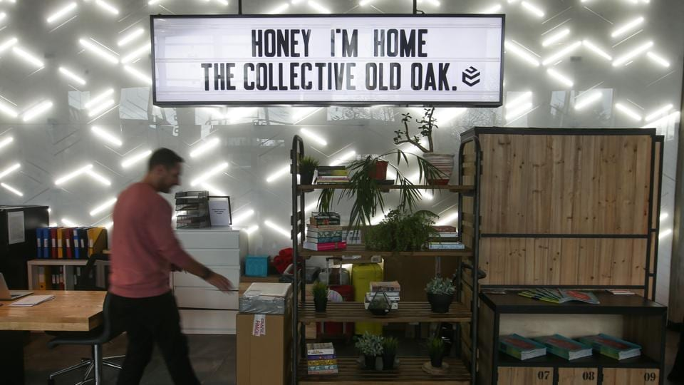 An employee is seen at 'The Collective Old Oak', a co-living building in London. Situated on a canal bank in north west London, the Old Oak opened in spring 2016 and has become a pioneer of 'co-living', a concept that is beginning to catch on elsewhere, most notably in the United States.  (Daniel Leal-Olivas / AFP)