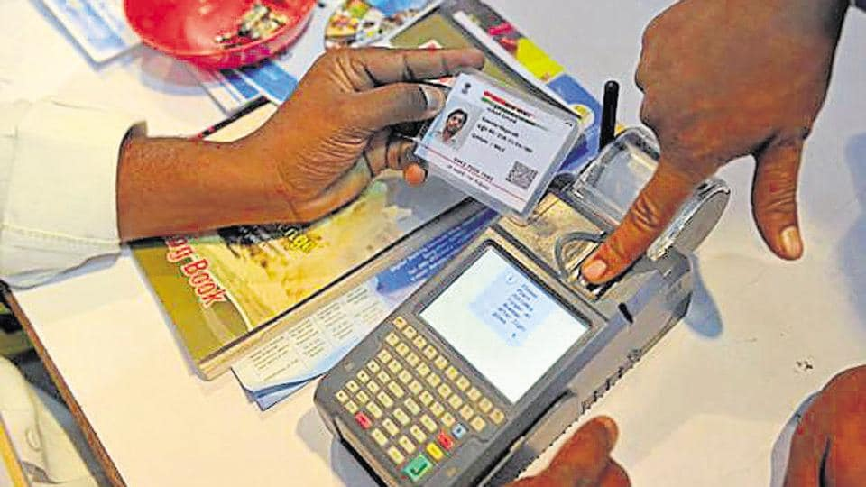 Visitor giving a thumb impression to withdraw money from his bank account with his Aadhaar or Unique Identification (UID) card during a Digi Dhan Mela, held to promote digital payment, in Hyderabad.