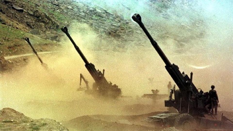 Indian artillery men fire 155mm Bofors guns at enemy positions from a gun emplacement in the Drass sector in Kashmir on June 22, 1999.
