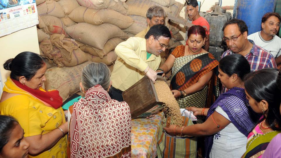 File photo of people purchasing foodgrains being distributed through a PDS shop in Jharkhand's Ranchi.
