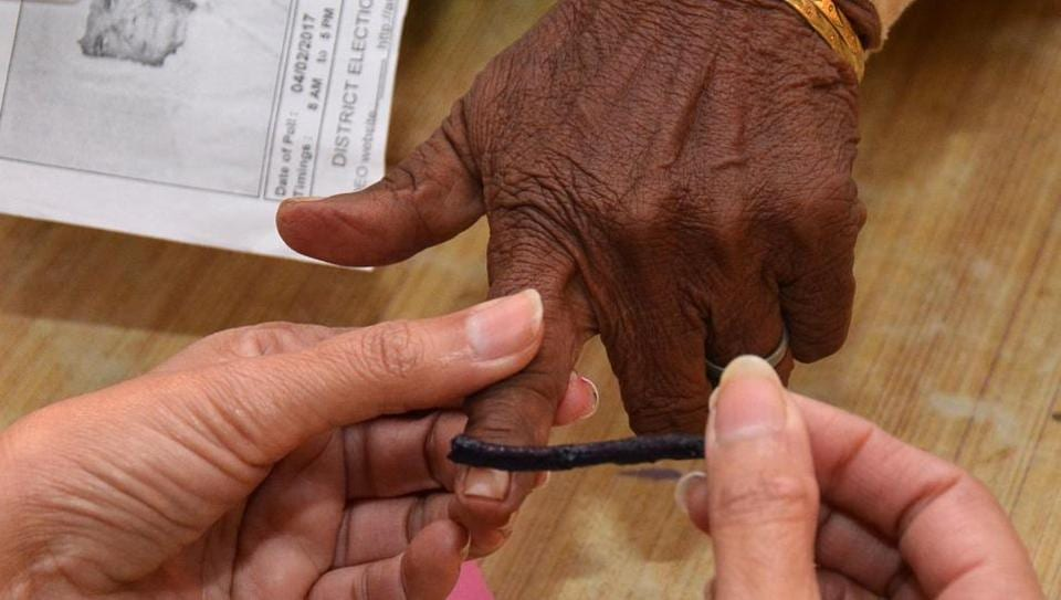 Polling agent applying the ink to the voter's finger polling station, Majitha in Amritsar on Saturday.