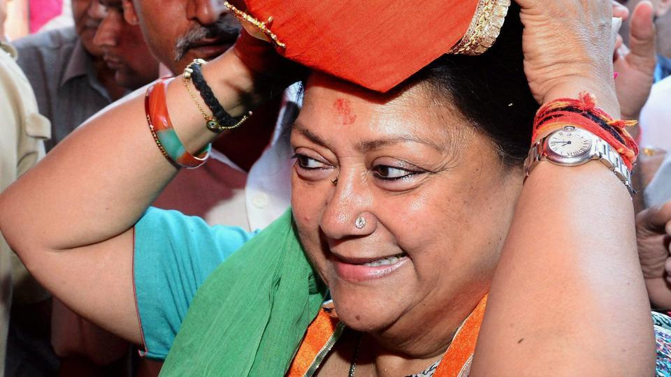 Rajasthan chief minister Vasundhara Raje wears a turban during a function in Ajmer/
