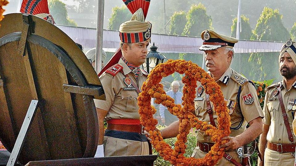 DGP Suresh Arora laying a wreath at the war memorial during the 58th Police Commemoration Day in Jalandhar on Saturday.
