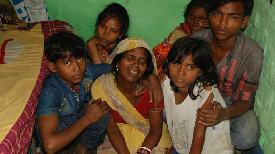 Family members of Baidyanath Ravidas following his death in Dhanbad on Saturday. The district administration has claimed that Ravidas suffered from asthma and died due to his ailment.