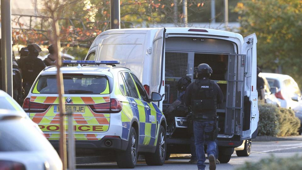 Police at the scene at Bermuda Park in Nuneaton, central England, where they are dealing with an ongoing incident, Sunday Oct. 22, 2017.