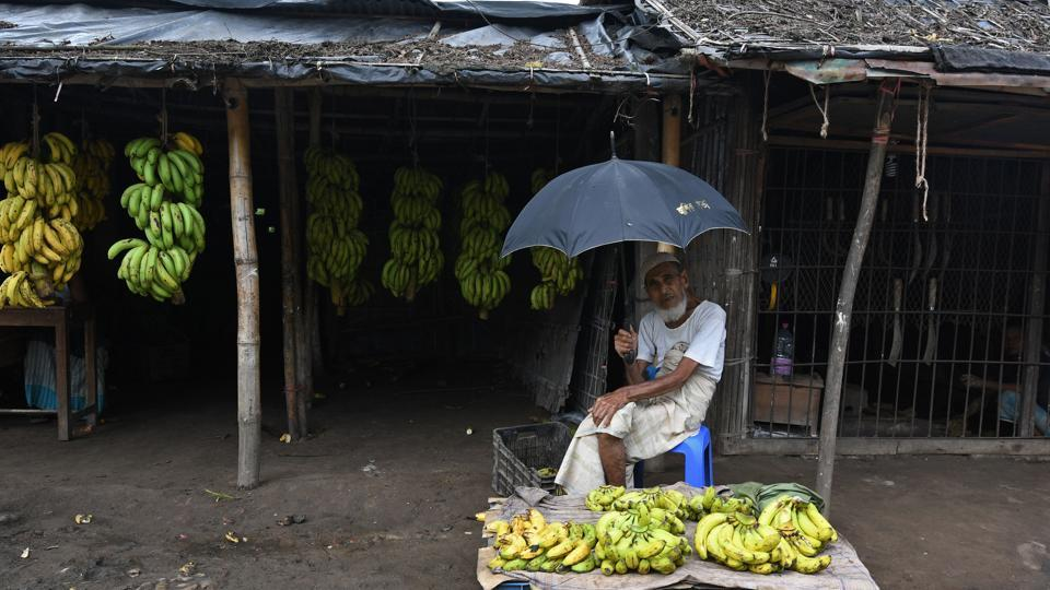 A man sits outside a banana shop near the Bangladeshi town of Teknaf on October 22, 2017.