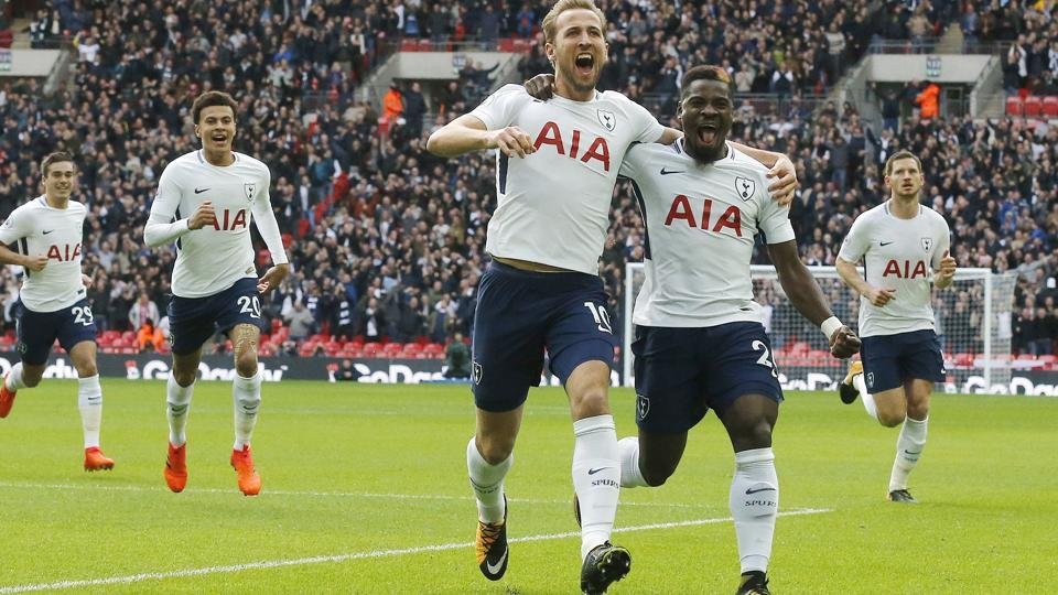 Tottenham Hotspur's Harry Kane celebrates after scoring his side's first goal against Liverpool.