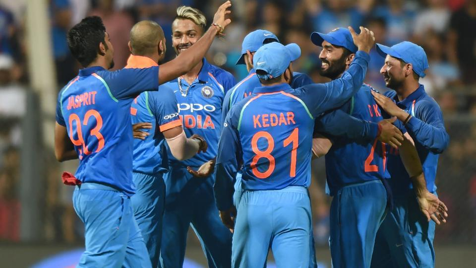 Indian cricket team players celebrate after the wicket of New Zealand batsman Martin Guptill. (AFP)