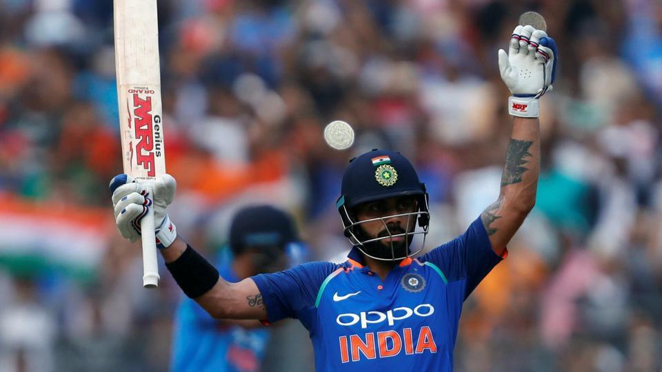 India captain Virat Kohli celebrates his century against New Zealand in Mumbai on Sunday.