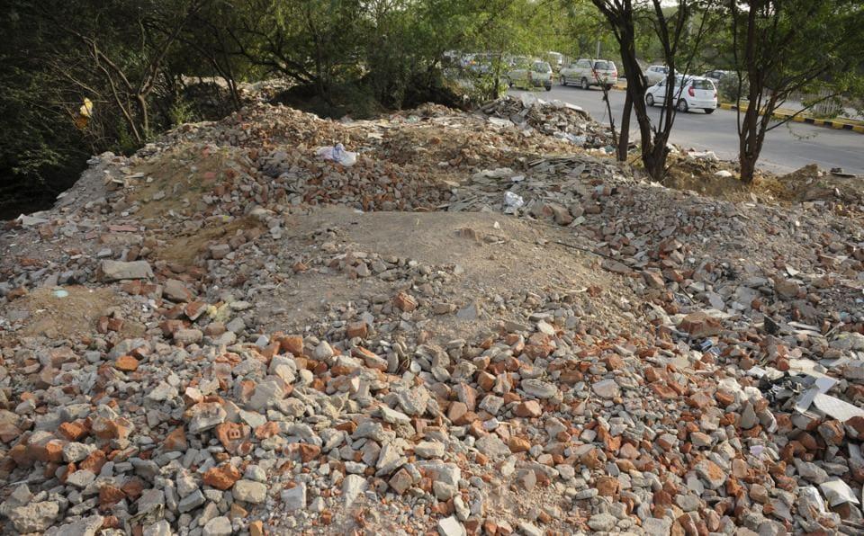 Construction waste dumped along Gurgaon-Faridabad Road.