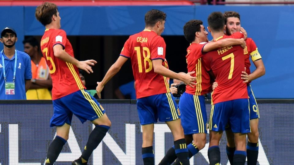 Spain players celebrate after beating Iran in the FIFA U-17 World Cup quarterfinal at the Jawaharlal Nehru Stadium in Kochi on Sunday.
