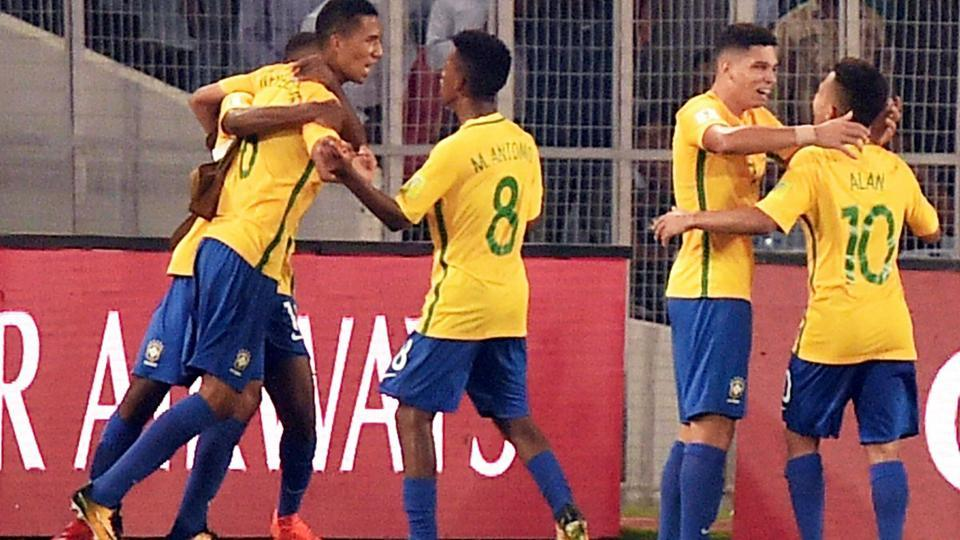 Brazil (yellow) players celebrate after scoring against Germany during a quarterfinal of the FIFA U-17 World Cup in Kolkata on Sunday.