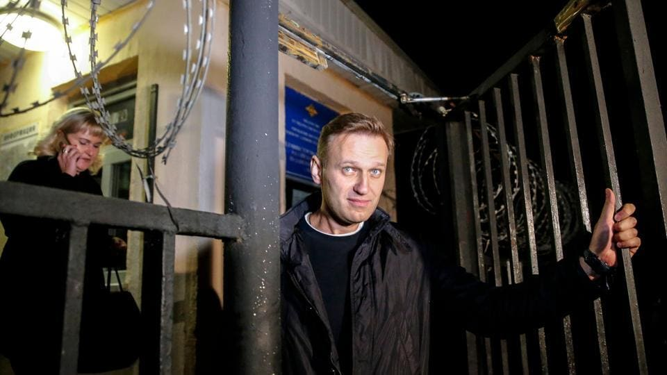 Russian opposition leader Alexei Navalny leaving a police station in Moscow on September 29.