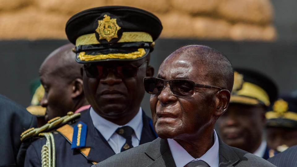 This file photo taken on April 12, 2017 shows Zimbabwe's President Robert Mugabe attending the burial of Brigadier General James Murozvi, who was granted national hero status by President Robert Mugabe, at the National Heroes Acre in Harare.