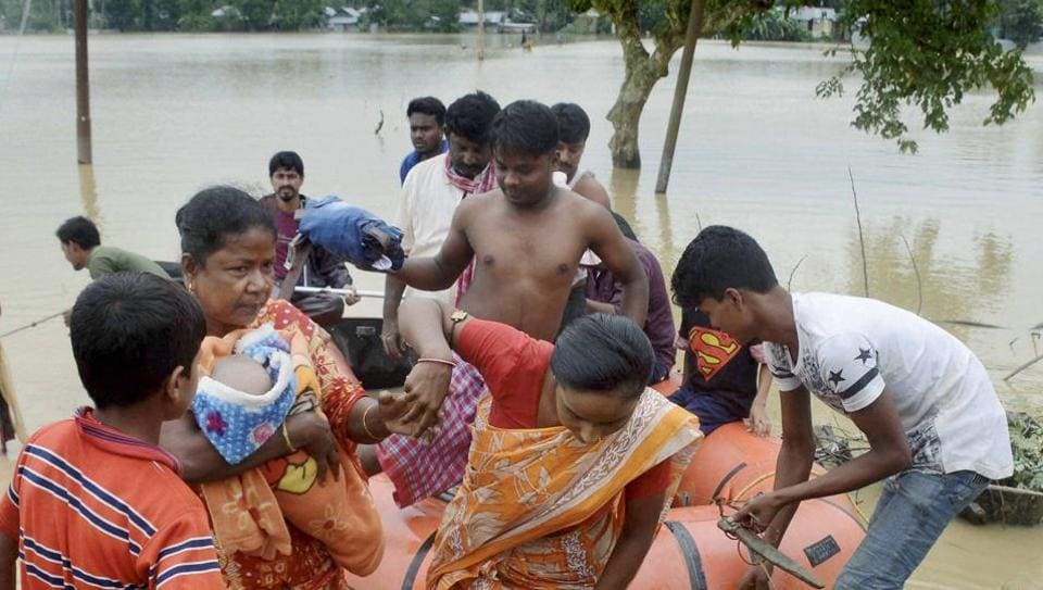 Civil defence personnel rescue villagers in a rubber boat from a flood-affected village in Agartala on Sunday.