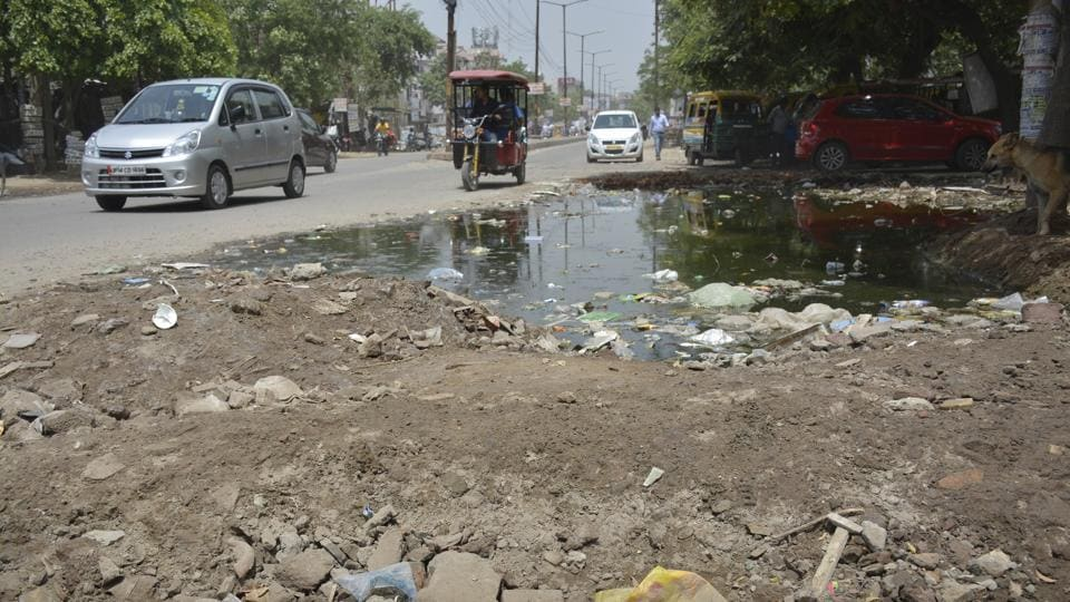 Ghaziabad, India - June 14: Broken roads at ESI hospital on road Rajendar Nagar in Ghaziabad, India, on Wednesday, June 14, 2016. UP had launched a drive to fill up potholes on as many as 11,107 roads within 40 days ie by June 15, with the Yogi Adityanath government allotting nearly Rs 1,400 crore for the work.