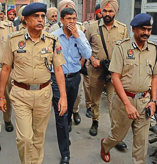DGP Suresh Arora (left) after meeting the family of deceased RSS leader Ravinder Gosain in Ludhiana on Sunday.