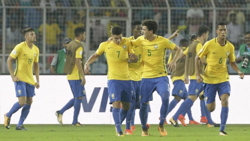 Brazil players celebrate after defeating Germany in a FIFA U-17 World Cup quarter-final in Kolkata on Sunday. (AP)