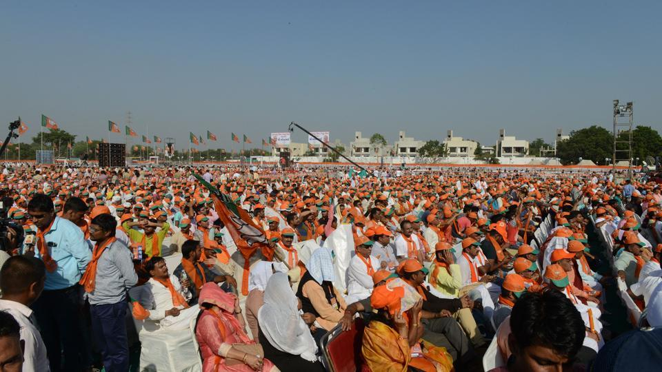 Supporters assemble to a gathering of Bhartiya Janta Party (BJP) in Gujarat on the outskirts of Ahmedabad on October 16, 2017.