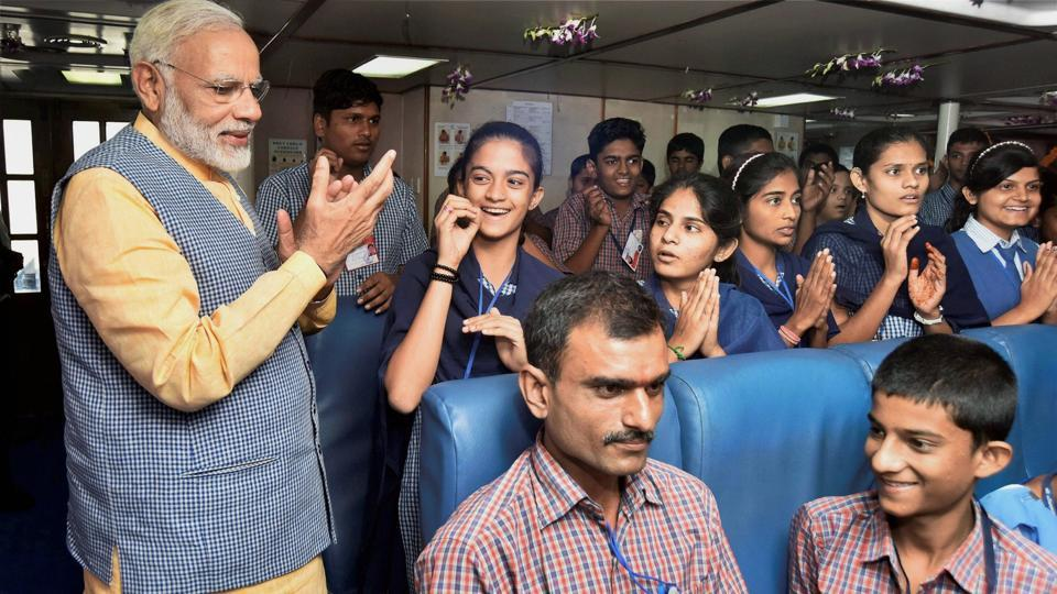 Prime Minister Narendra Modi interacts with the children during his maiden voyage on the Ghogha-Dahej Ro-Ro ferry service in Bhavnagar, Gujarat on Sunday.