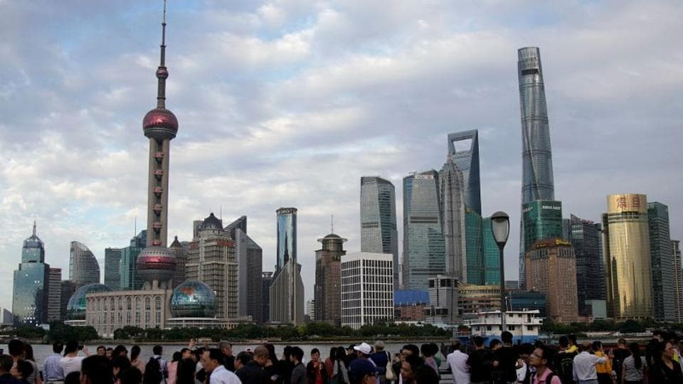 People visit the Bund in front of Shanghai's financial district of Pudong in Shanghai, China September 28, 2017.