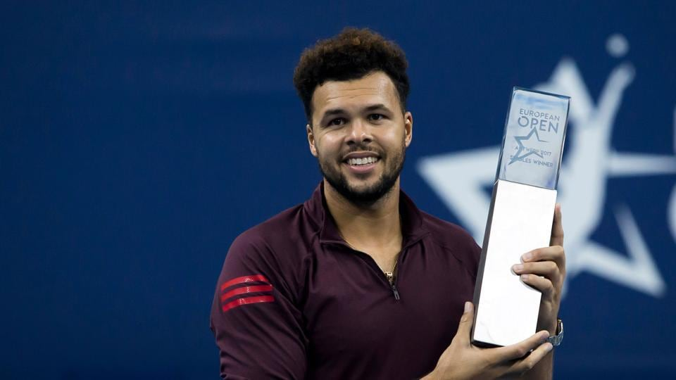 Jo-Wilfried Tsonga poses with the winner's trophy after defeating Diego Schwartzman at the ATP Antwerp tennis tournament.