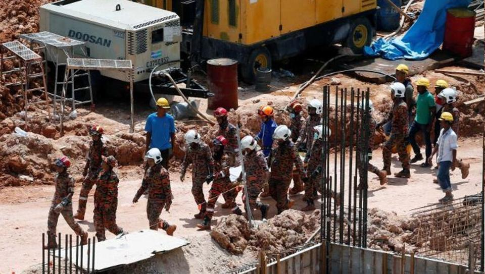 Toll rises in Malaysian landslide, 11 dead
