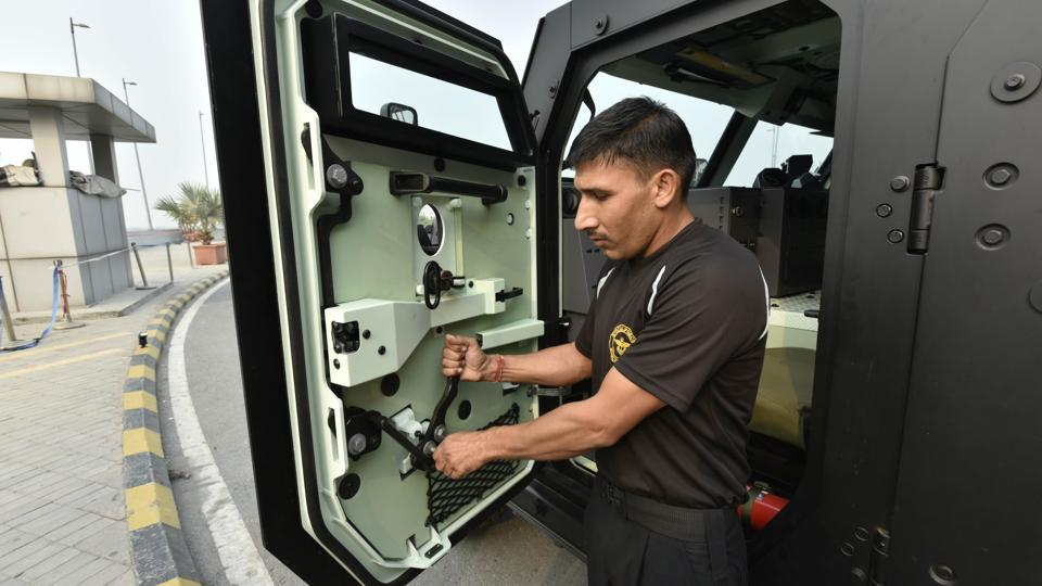 'The vehicle is bulletproof with four gates. Every gate has a space to put a gun out of it and a bulletproof glass above the space so that the personnel can see the target. The vehicle can run at a speed of 120km/hr and is fully automatic,' said a CISF officer, who has been trained in using the vehicle. (Vipin Kumar / HT Photo)