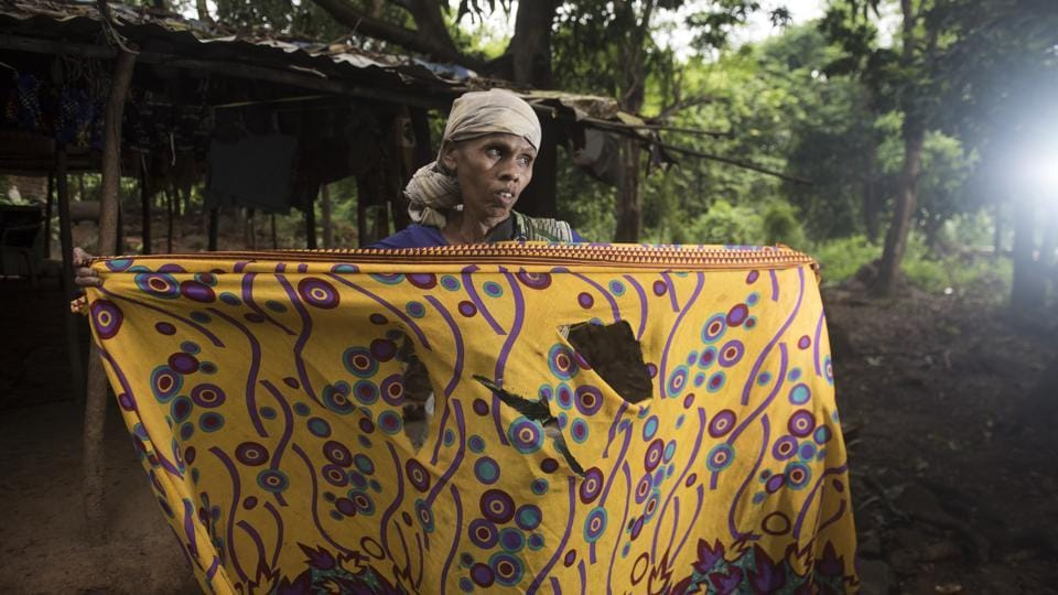 Bayaji Dadu Bendre, 45, from Chafacha pada in Aarey, faced her worst fears when she was attacked by a leopard on Dussehra, while out to relieve herself in a farm near her home. Lacking basic facilities such as electricity and toilets, the inhabitants of these villages, mostly members of the Warli tribe, don't step outside, making do with buckets and lanterns as the predators' shadows loom close outside. (Satish Bate / HT Photo)