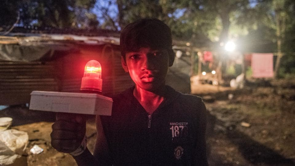 The forest department has installed emergency blinking lights at the corners of hamlets to ward off leopards. Nathu Rathod, CEO Aarey promises that electricity will come to the hamlets by March 2018 eliminating this need. Bhoir, counters that only a few houses have these lights, a sign '...that authorities want us to shift to slum rehabilitation authority (SRA) buildings and free these areas for more infrastructure development'. (Satish Bate / HT Photo)