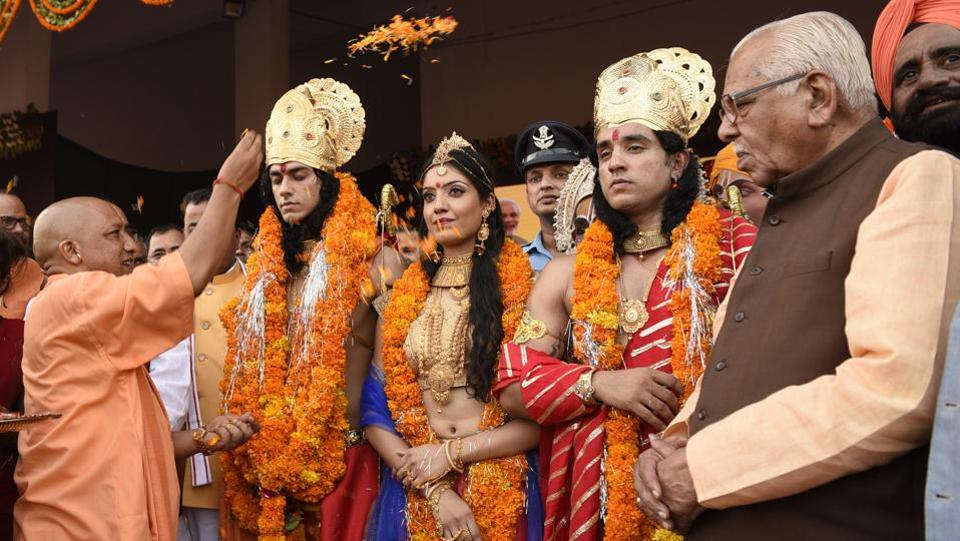 UP chief minister Yogi Adityanath worships artists dressed as Ram and Sita in Ayodhya. Analysts feel the saffron party wants to keep alive Hindutva issues that propelled it to national importance in the 90s, on the back of a movement around the building of a Ram Temple in Ayodhya.