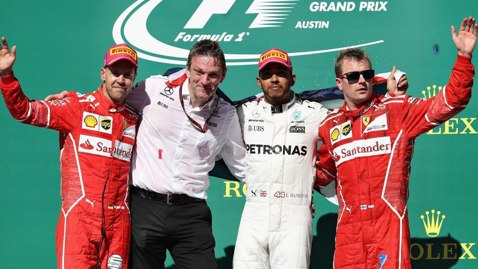 Top three finishers - Lewis Hamilton of Mercedes, Sebastian Vettel of Ferrari, Kimi Raikkonen of  Ferrari. (AFP)