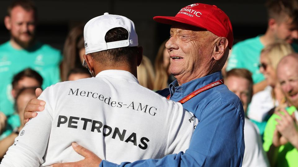Lewis Hamilton celebrates with Mercedes GP executive chairman Niki Lauda. (AFP)