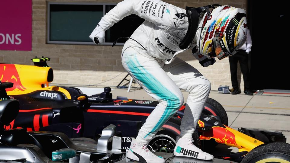 Lewis Hamilton of Great Britain and Mercedes GP celebrates in parc ferme during the United States Grand Prix. (AFP)