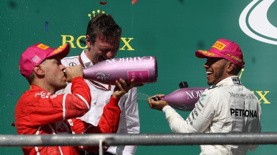 Lewis Hamilton celebrates on the podium with Sebastian Vettel of Germany and Ferrari and James Allison, Technical Director at Mercedes GP. Hamilton later stated he was surprised at the lack of fight put up by Vettel.