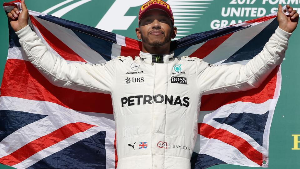 Lewis Hamilton of celebrates on the podium after winning the United States Formula One Grand Prix. (AFP)