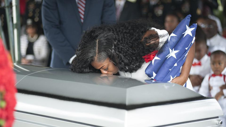 File photo taken on October 21, 2017 shows Myeshia Johnson as she kisses the casket of her husband, Sgt La David Johnson, during his burial service at the Memorial Gardens East cemetery in Hollywood, Florida. President Donald Trump struggled to remember the name of the soldier killed in an ambush in Niger when he called Myeshia Johnson for condolences, the woman told ABC.