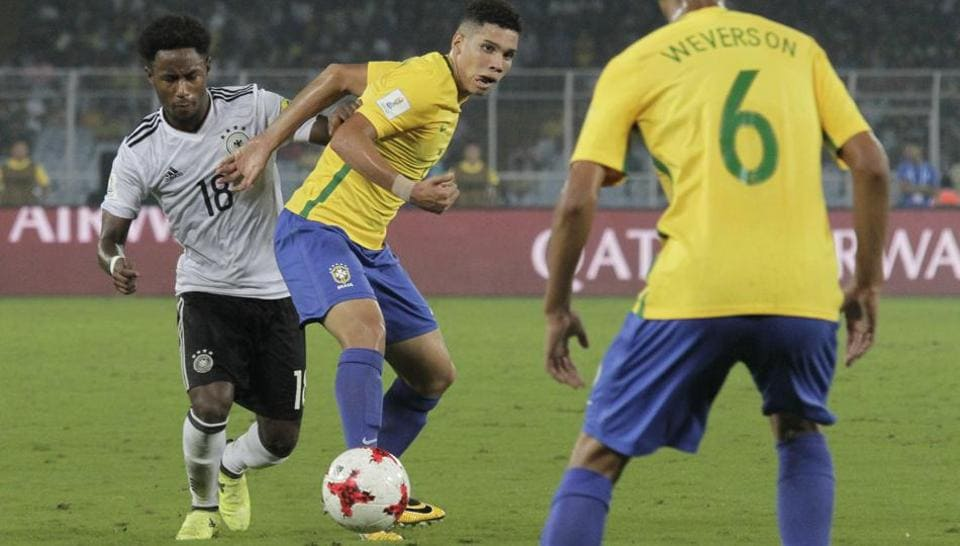 Brazil's Paulinho duels for the ball against Germany's John Yeboah during their FIFA U-17 World Cup quarter final match.