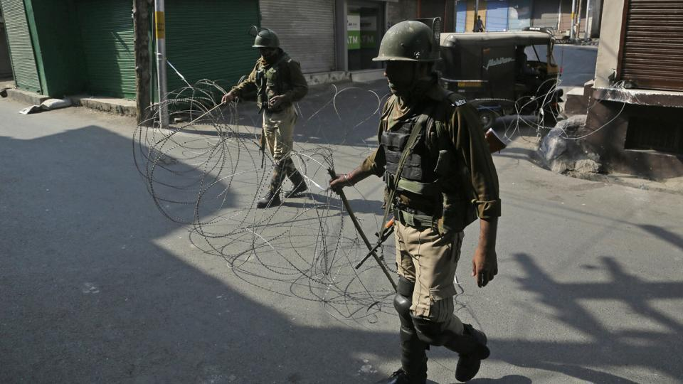 File photo of paramilitary soldiers closing a street with a barbwire during a strike called by separatists.
