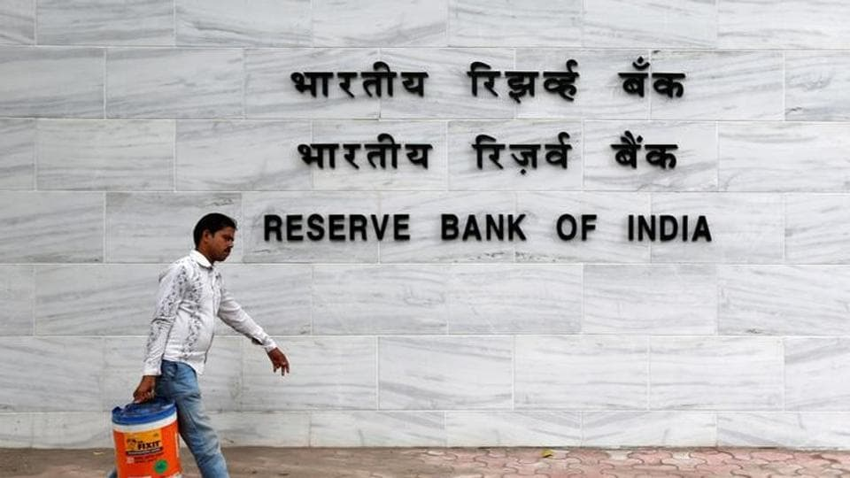 A man walks past the Reserve Bank of India (RBI) head office in Mumbai, June 7, 2016.