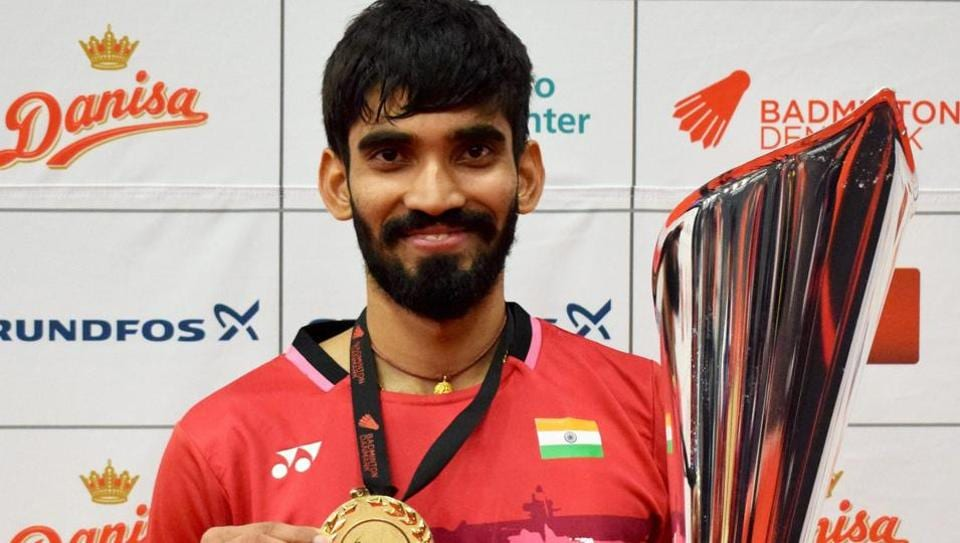 Kidambi Srikanth poses with trophy after winning the Denmark Open Super Series Badminton Championship in Odense on Sunday.