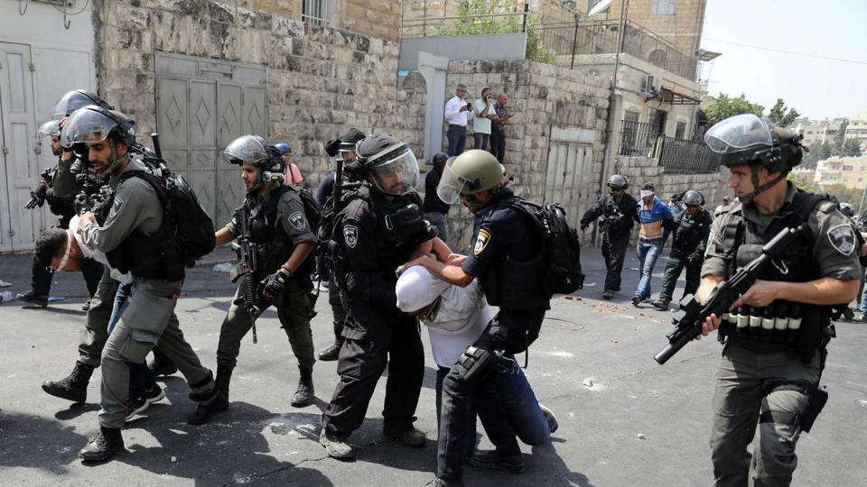 Israeli security forces arrest Palestinian men following clashes outside Jerusalem's Old city.