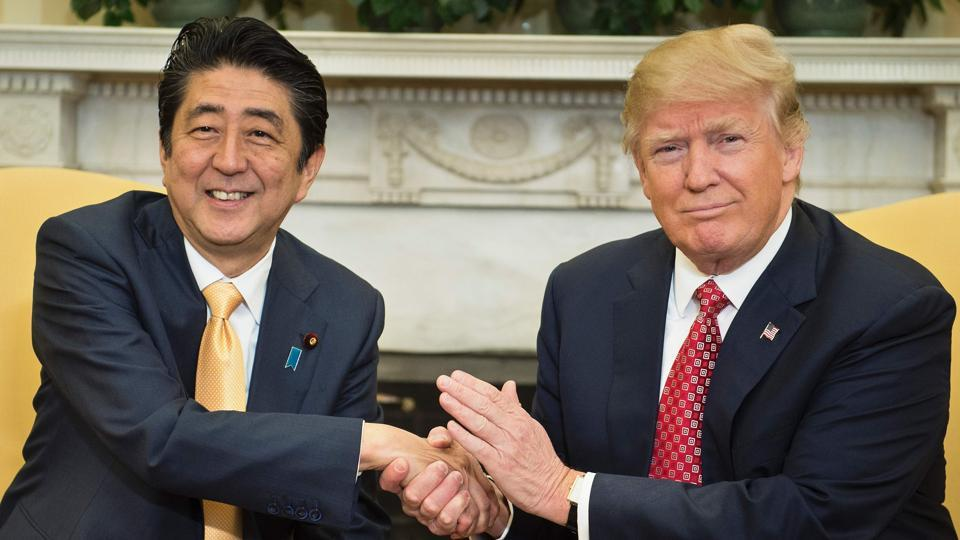 Japan's Prime Minister Shinzo Abe and US President Donald Trump shake hands before a meeting in the Oval Office of the White House February 10, 2017 in Washington, DC.