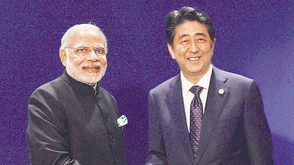 Prime Minister Narendra Modi and his Japanese counterpart Shinzo Abe shake hands during a meeting in Paris on the sidelines of CoP 21 summit on climate change.