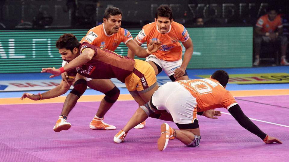 Players of Puneri Paltan (Orange jersey) and U P Yoddha(Brown Jersey) in action during Pro Kabaddi League.