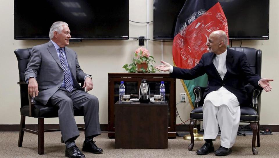 US secretary of state Rex Tillerson speaks with Afghan President Ashraf Ghani at the Bagram Air Field in Afghanistan.