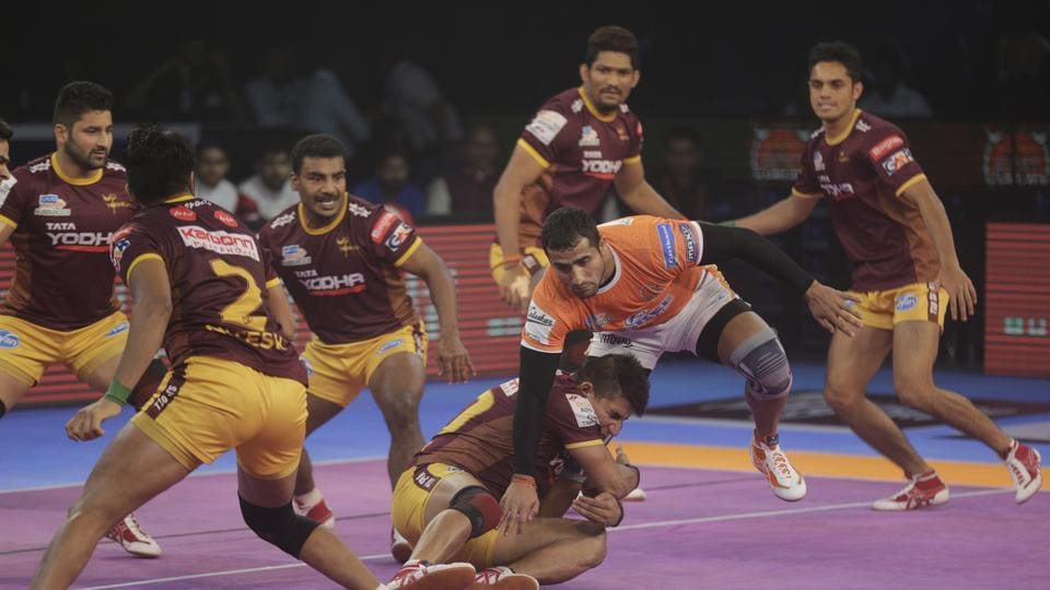 Sandeep Narwal of Puneri Paltan is pinned down by UP Yoddha players during their Vivo Pro Kabaddi league match in Mumbai on October 23.